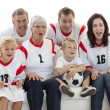 Excited family watching football match in television — Stock Photo #10298064
