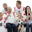Family watching a football match in television — Stock Photo #10298066