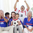 Family watching football match in television — Stock Photo #10298067