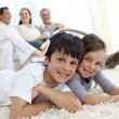 Children on floor listening to music in living-room — Stockfoto #10298072