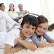 Stock Photo: Children on floor listening to music in living-room