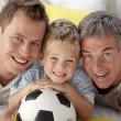 Foto Stock: Portrait of smiling son, father and grandfather on floor