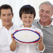 Son holding a rugby ball with his father and grandfather — Stock Photo