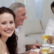Woman celebrating Christmas dinner with her family — Stock Photo