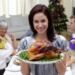 Woman showing to the camera Christmas turkey — Stock Photo