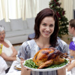 Royalty-Free Stock Photo: Woman showing Christmas turkey for family dinner