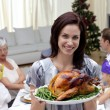 Woman showing Christmas turkey for family dinner — Stock Photo #10298120