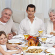 Foto Stock: Family having dinner together at home