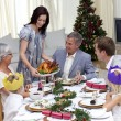Happy family celebrating Christmas dinner with turkey — ストック写真