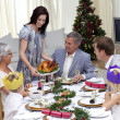 Foto Stock: Happy family celebrating Christmas dinner with turkey