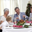 Stock Photo: Family eating turkey in Christmas Eve