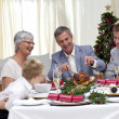 Family eating turkey in Christmas Eve - Stock Photo