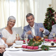 Stock Photo: Family eating turkey in Christmas Eve Dinner