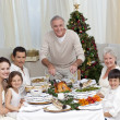 Grandfather cutting turkey for Christmas dinner — Stock Photo #10298134