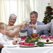 Family drinking a toast in a Christmas dinner — Stock Photo #10298140