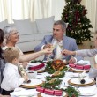 Family tusting in a Christmas dinner with champagne — Stock Photo