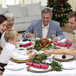 Children pulling a Christmas cracker at home — Stock Photo #10298159