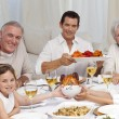Grandparents, parents and children having a family dinner — Stockfoto