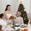Woman showing turkey to her family for Christmas — Stock Photo