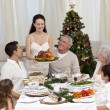 Mother showing turkey to her family for Christmas — Stock Photo