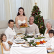 Family celebrating Christmas dinner with turkey — Stockfoto