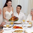 Woman showing turkey to her family for Christmas dinner — Stock Photo