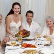 Family eating turkey in a dinner — Stock Photo