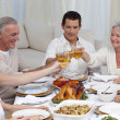 Family tusting with wine in a dinner — Stock Photo