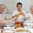 Happy family tusting with wine in a dinner — Stock Photo