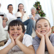 Brother and sister on floor with their family in Christmas — Stock Photo #10298181