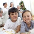 Smiling children looking for presents in Christmas boots — Stock Photo