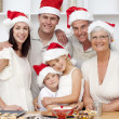 Smiling family baking Christmas cakes - ストック写真