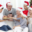 Happy family at Christmas time — Stock Photo #10298201