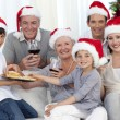 Happy family at Christmas time — Stock Photo