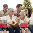 Stock Photo: Family giving presents for Christmas