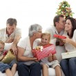 Family giving presents for Christmas - Stock Photo