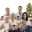 Family drinking wine and eating sweets in Christmas — Stock Photo