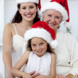 Stock Photo: Daughter, mother and grandmother baking Christmas cakes