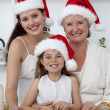 Daughter, mother and grandmother baking Christmas sweets — Stock Photo