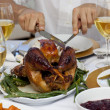 Stock Photo: Close-up of a man cutting a turkey for Christmas dinner