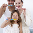 Family cleaning their teeth in bathroom — Stock Photo #10298321