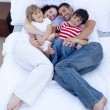 High view of family relaxing in bed — Stock Photo