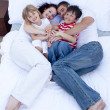 High view of parents and children relaxing in bed — Stock Photo #10298425