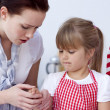Little girl injured by a knife in kitchen — Stock Photo #10298440