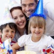 Portrait of happy family celebrating a birthday — Stock Photo #10298441