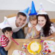 Little girl celebrating her birthday with her family — Stock Photo