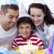 Little boy celebrating his birthday with his family — Stock Photo