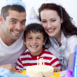 Little boy celebrating his birthday with his parents — Stock Photo