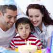 Little boy blowing out candles on his birthday's day — Stock Photo