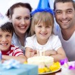 Smiling family celebrating a birthday — Stock Photo